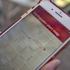 A smartphone displays an earthquake-alert map of Los Angeles.