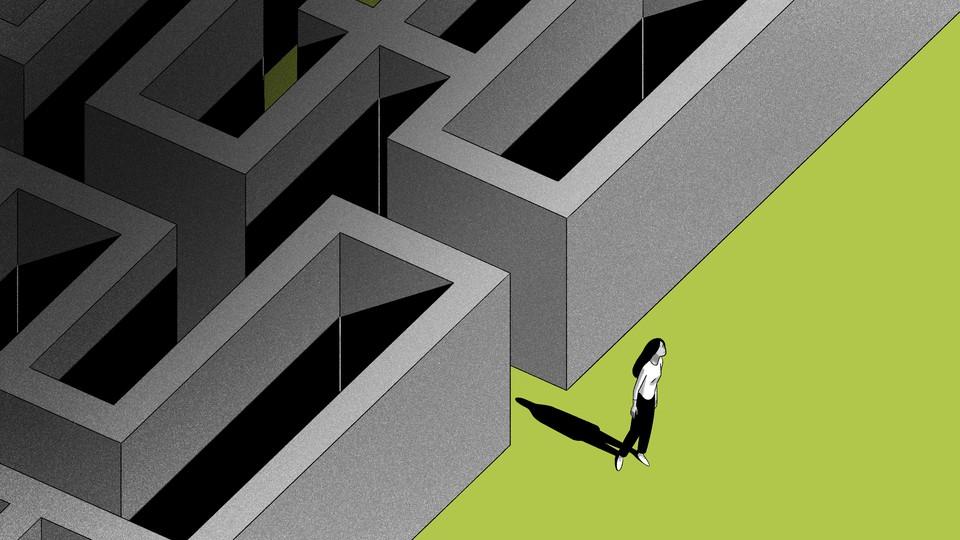 A woman exiting a maze.