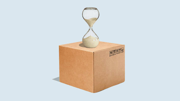 An illustration of a cardboard box with an hourglass on top