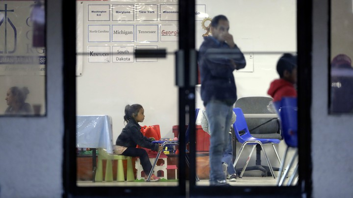 Immigrants wait in a humanitarian center in Texas.
