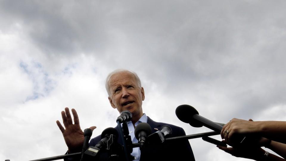 Joe Biden speaks with reporters in New Hampshire.