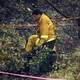 A wildfire investigator stands in a thicket.