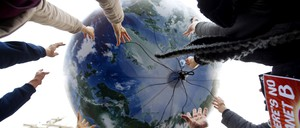 Hands reaching up toward a floating globe