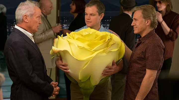 Udo Kier, Matt Damon with a big flower, and Christoph Waltz in 'Downsizing'