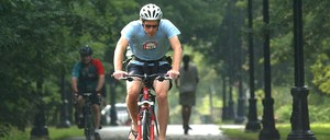 A photo of a cyclist riding along the Charles River in Cambridge, Massachusetts.