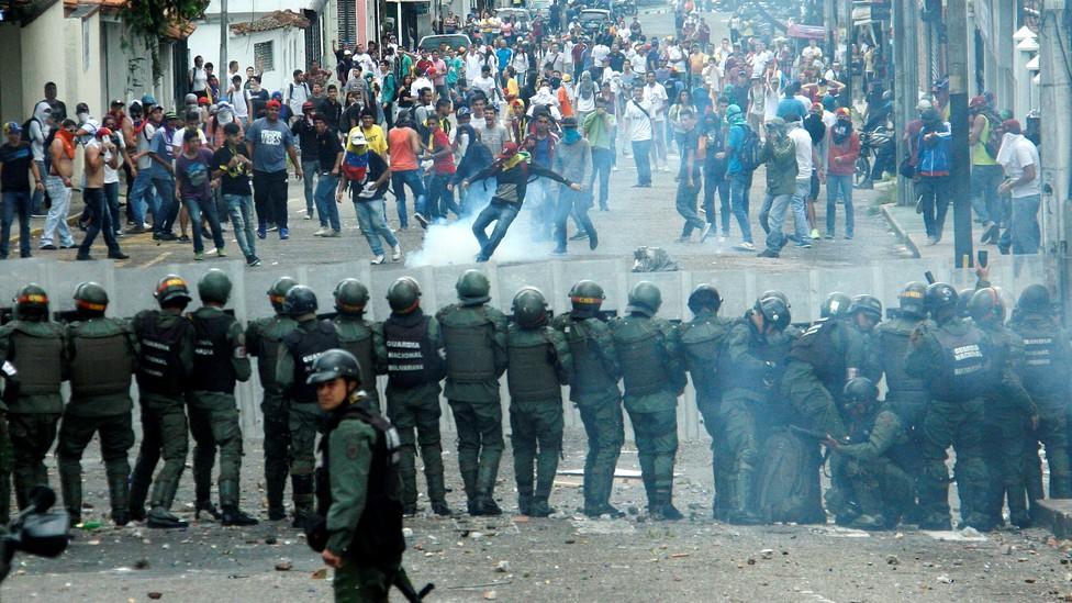 Demonstrators clash with members of Venezuelan National Guard