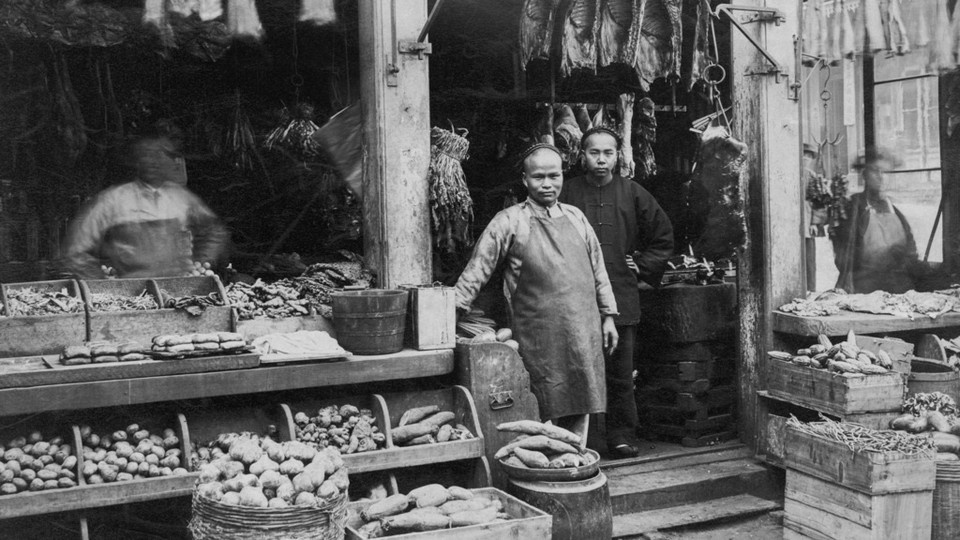 A Chinese butcher and grocery store in San Francisco, 1885.