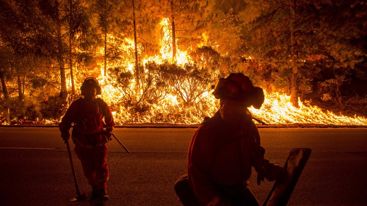 Firefighters battle the King Fire near Fresh Pond, California, in September 2014.