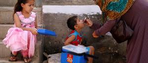 Children receiving polio drops in Aprll during an anti-polio campaign in Karachi, Pakistan.