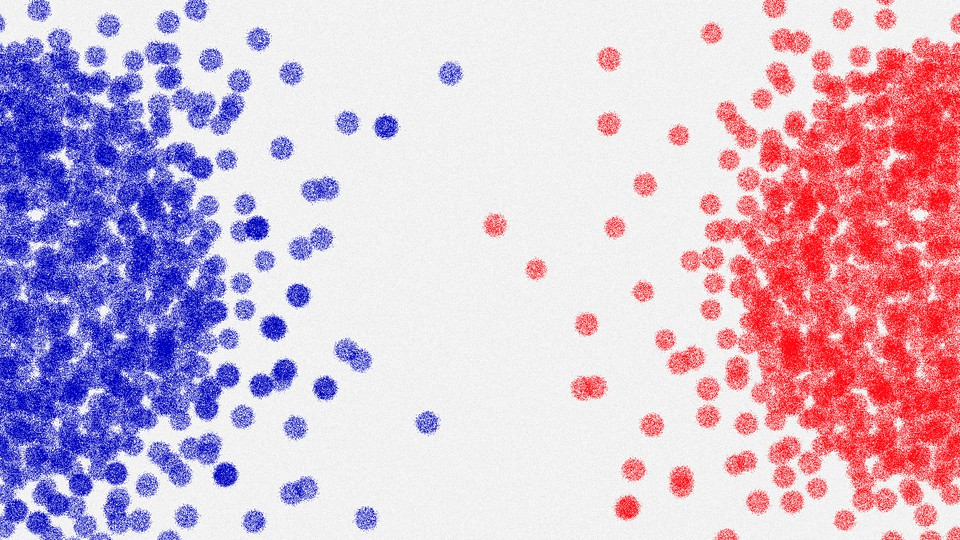 An illustration of red and blue spheres mixing