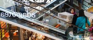 Shoppers ride escalators inside a mall in Vina del mar, Chile.