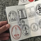 A heavily stamped passport with lighthouse icons