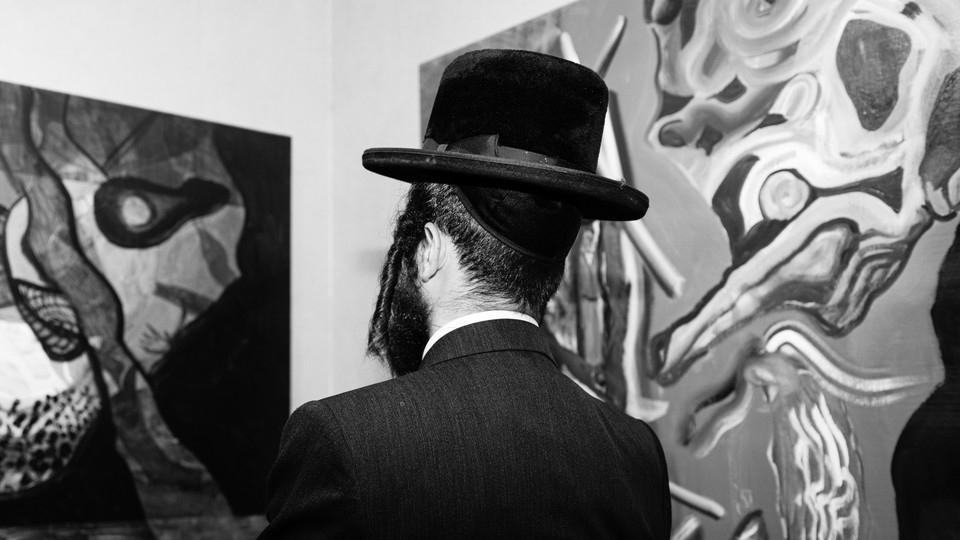 A man admiring art in a gallery