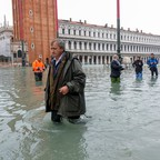 photo: Mayor Luigi Brugnaro walks on St Mark's Square as exceptionally high tidal flooding engulfed the city.