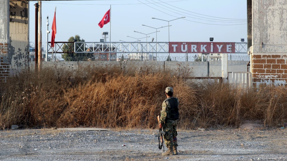 A Turkey-backed Syrian rebel fighter is seen in the town of Tal Abyad.