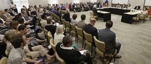 A crowded room of residents attend a local public forum in Chapel Hill, North Carolina.