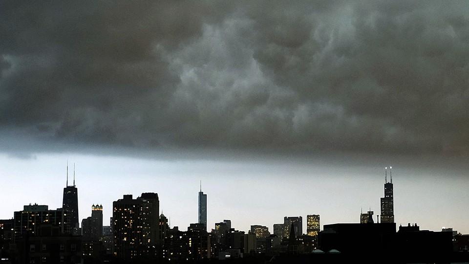 The Chicago skyline under a dark cloud