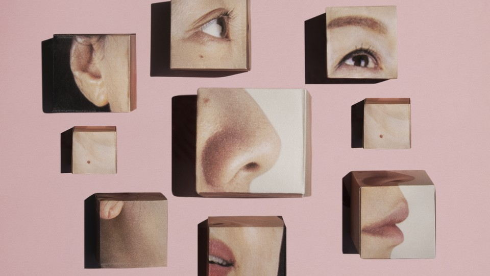 Illustration of the parts of a face, separated into cubes