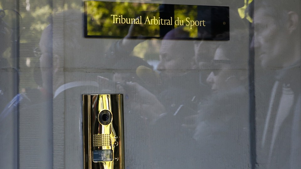 A door with a sign for the Court of Arbitration for Sport
