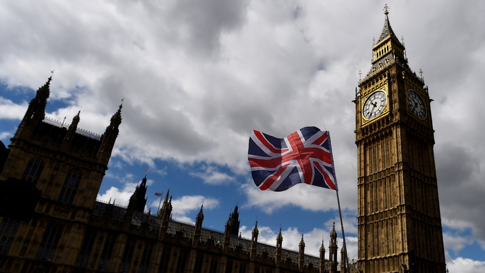 The Union Flag flies near the Houses of Parliament in London