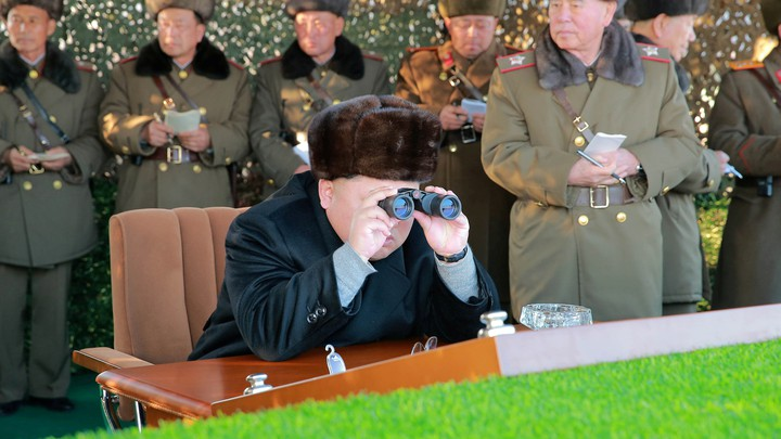 North Korean leader Kim Jong Un guides a firing contest among multiple launch rocket system batteries.