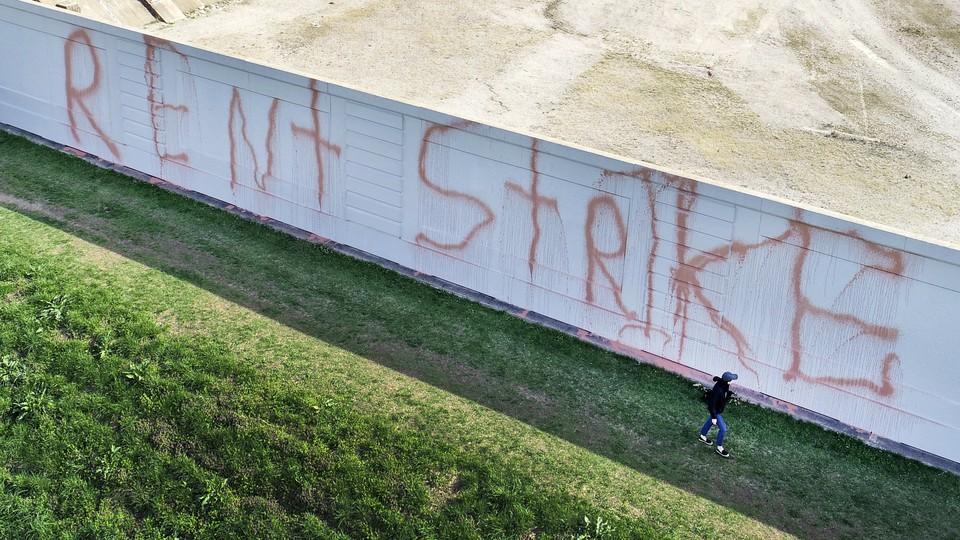 "A building with ""Rent Strike"" written across it"