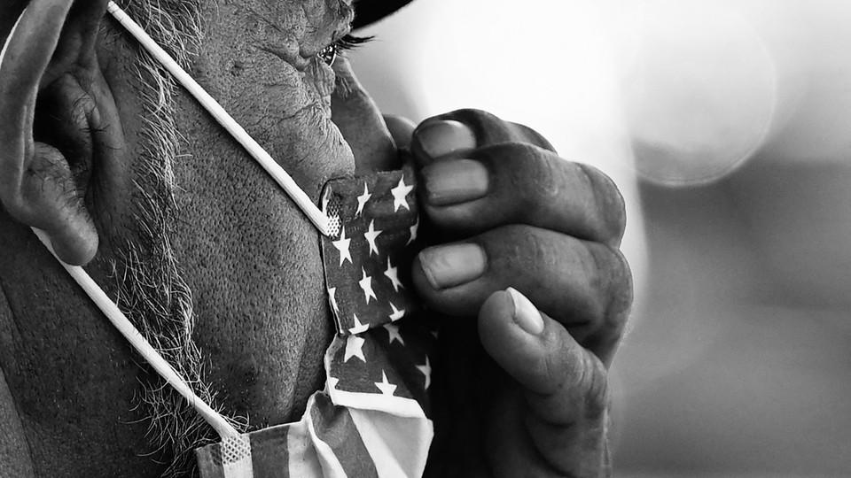 Man wearing an American flag facemask