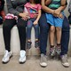 Women and children sit in a holding cell at a U.S. Border Patrol center
