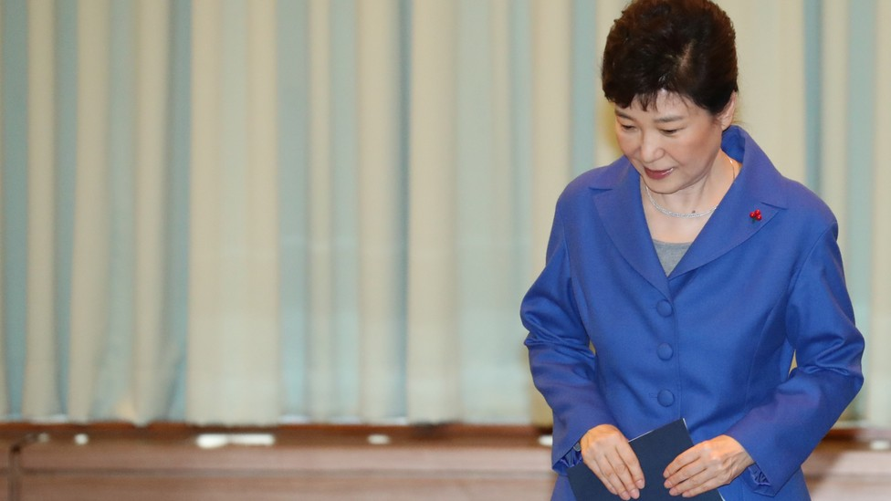 Park Geun-Hye arrives at an emergency cabinet meeting on December 9.