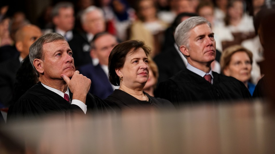 Supreme Court Justices John Roberts (<i>left</i>), Elena Kagan, and Neil Gorsuch