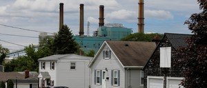A power plant behind a row of homes in Somerset, Massachusetts.