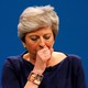 Prime Minister Theresa May coughs as she addresses the Conservative Party conference.