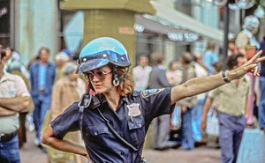 A photo of a motorcycle cop directing traffic outside Haymarket Square in Boston in 1979