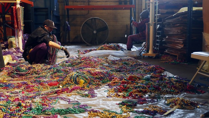 Sorting through Mardi Gras beads to recycle in New Orleans.