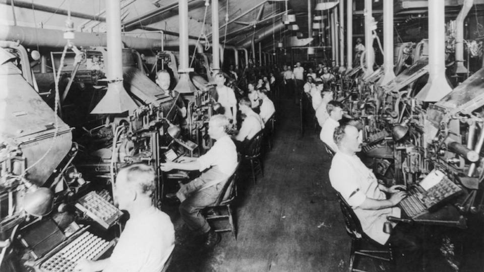 The New York Herald's composing room, filled with linotype machines, circa 1902