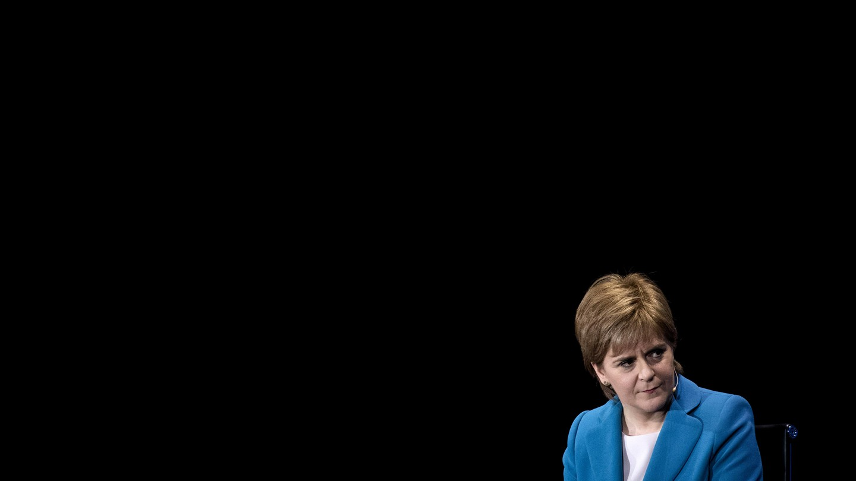 Nicola Sturgeon in blue on black background