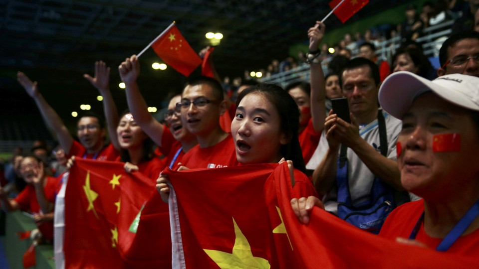 Fans cheer on Chinese athletes at the 2016 Olympics.