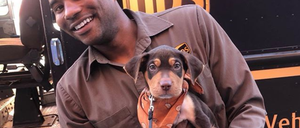 Jason Hardesty poses with a pup outside a New Orleans bar.
