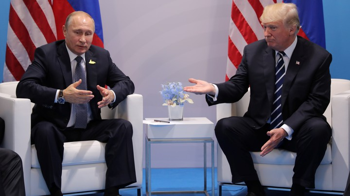 Russia's President Vladimir Putin talks to U.S. President Donald Trump