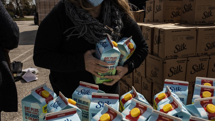 A volunteer prepares food to be delivered during a food distribution for laid off casino workers due to the COVID-19 pandemic at the Harbor Square Mall in Egg Harbor Township, N.J.
