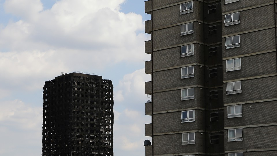 The burnt remains of Grenfell Tower pictured next to another high risein west London on June 17, 2017.