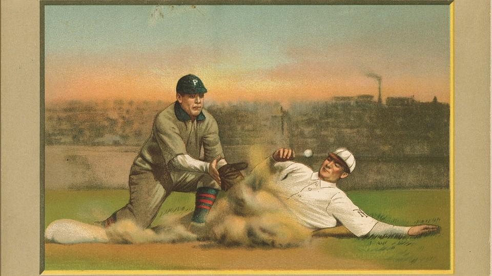 A baseball player sliding into a base