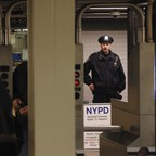 photo: a police officer in the NYC subway.