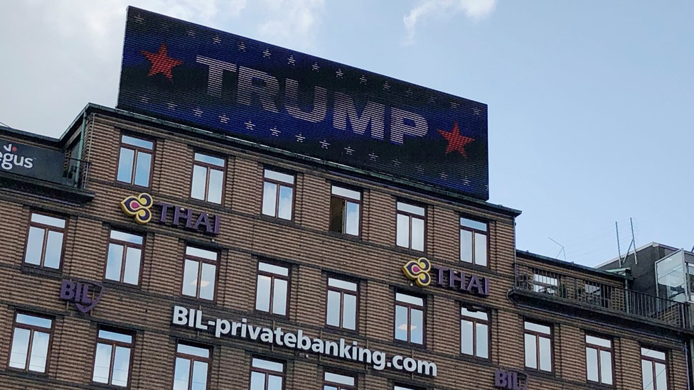 "A digital billboard displays a sign reading ""TRUMP"" in Copenhagen."