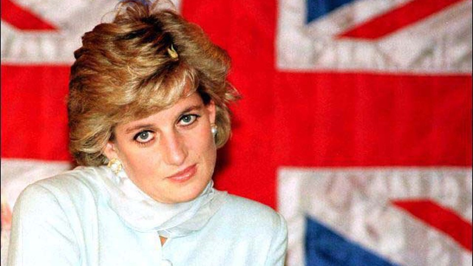 Princess Diana sitting in front of a British flag