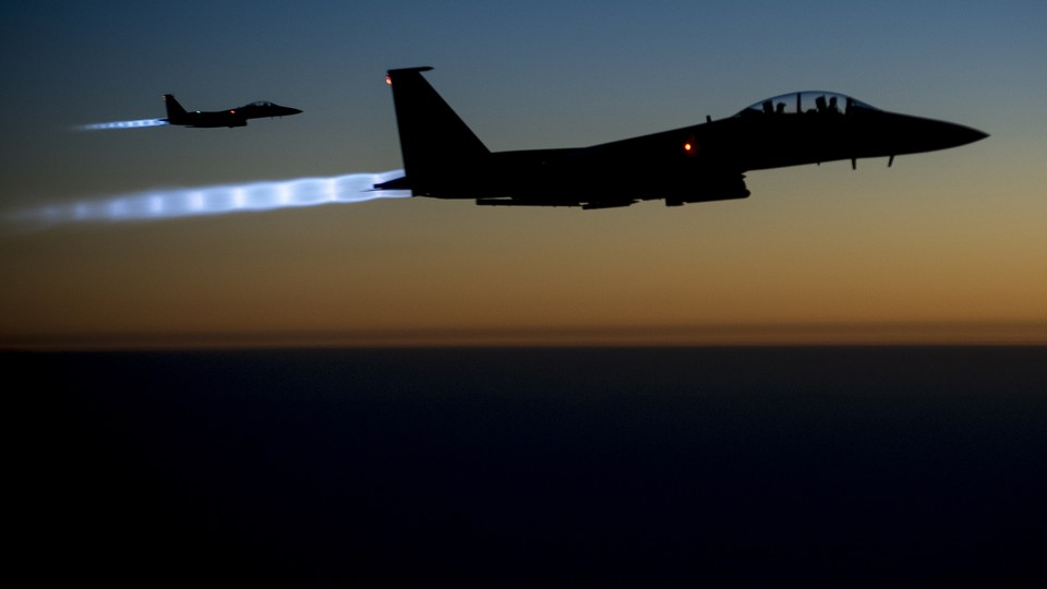 A pair of U.S. Air Force F-15E Strike Eagles fly over northern Iraq after conducting airstrikes in Syria onSeptember 23, 2014.