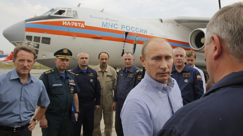 Putin meets with pilots at the airport in Voronezh, which will be renamed for Czar Peter the Great.