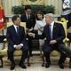 President Trump gestures his hand towards South Korean President Moon Jae-in