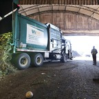 A truck dumps compost materials inside a receiving area at the Cedar Grove processing facility near Seattle, Washington.