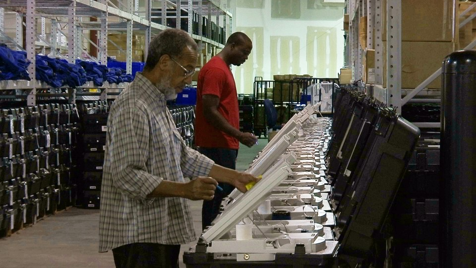 Voters use electronic voting machines.